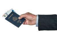 Senior caucasian hand holding US passport with Euros