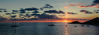 Panorama of sunset above the Mediterranean Sea and sailboats silhouette. Ibiza, Spain