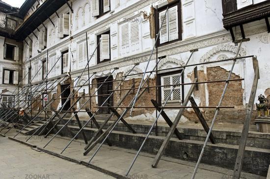 Braces at the quake-damaged old royal palace in the Coronation Courtyard, Kathmandu, Nepal