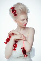 beautiful albino young woman with red lips