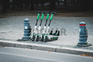 Electric E scooter , escooter or e-scooter of the ride sharing company LIME on sidewalk in Berlin