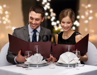 couple with menus at restaurant
