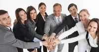 Business people hold pile hands