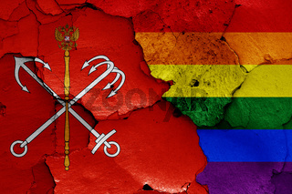 flags of Saint Petersburg and LGBT painted on cracked wall