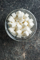 Sweet white sugar cubes.