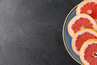 close up of fresh juicy grapefruits on plate