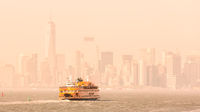 Staten Island Ferry and Lower Manhattan Skyline, New York, USA.