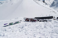 Snowboards on snowy slope in high winter mountains