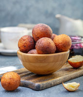 Cottage cheese donuts in a wooden bowl.