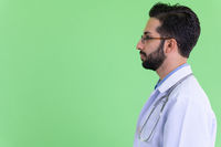 Closeup profile view of young bearded Persian man doctor