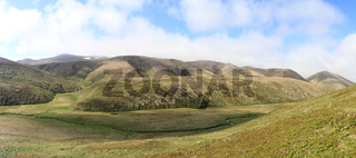 Panorama of hillock and the valley of the river on the island of Copper in a summer sunny day