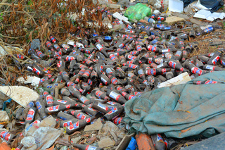 garbage on the side of the road beer bottles