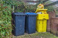 Gray, blue and yellow garbage bin for residual waste, paper and packaging.