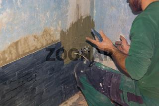 Tiler sticks tiles
