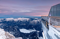 View of frozen lake Eibsee from Zugspitze mountain summit at daybreak