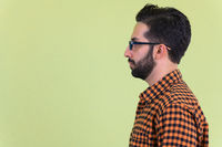 Closeup profile view of young bearded Persian hipster man