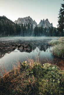 Antorno lake with famous Dolomites mountain peak of Tre Cime di Lavaredo in background in Eastern Dolomites, Italy Europe. Stunning nature scenery and scenic travel destination.