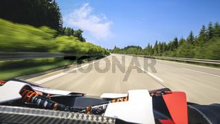 Super fast ride in convertible sportscar.