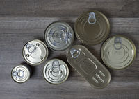 Tin cans for food on wooden background. Top View.
