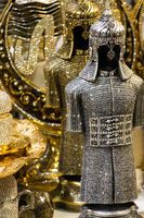 Medieval steel and gold colored armours on display