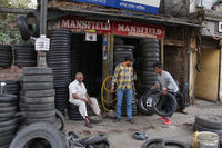 PUNE, MAHARASHTRA, February 2019, Workers at garage and puncture repair shop