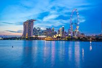 Singapore city skyline at twilight with view of Marina Bay