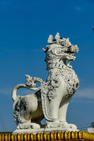 chinese lion statue in front of the palace, digital photo picture as a background