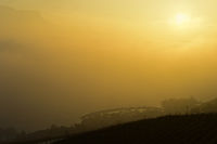 Sunset in the golden autumn fog on Lake Geneva at the yacht harbour Port de la Pichette, Corseaux,