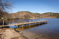 Dock by the lake in Norway, early spring at Tjomsevannet in Sogne.