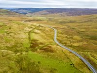 Aerial view of the border between Scotland and England with large stone and Scotland sign - United Kingdom