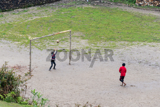 Children playing football in Ghalegaun, Nepal