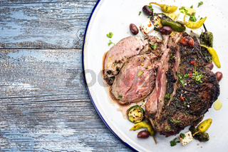Barbecue marinated lamb roast with vegetable and feta as close-up in a bowl