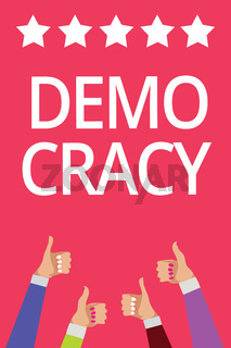 Word writing text Demo Cracy. Business concept for freedom of the people to express their feelings and beliefs Men women hands thumbs up approval five stars information pink background.