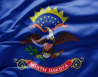 Waving state flag of North Dakota - United States of America