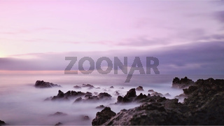 Evening mood on the Atlantic Ocean in gentle purple tones in HD recording.