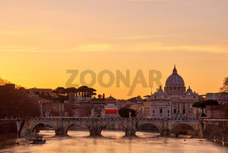 St. Peter's cathedral and Tiber river at sunset in Rome