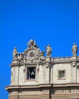 Clock on facade of Saint Peter Basilica. Vatican City, Rome, Italy