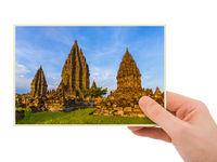 Hand and Prambanan temple in Indonesia (my photo)
