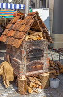 Old bricked baking oven on a market