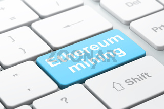 Cryptocurrency concept: Ethereum Mining on computer keyboard background