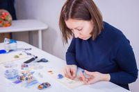 Designer making handmade eardrop