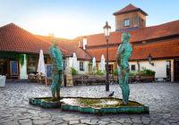 Pissing men statues in Prague