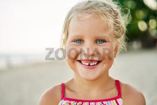 Close up portrait of happy cute little girl