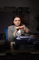 Female employee suffering from excessive work