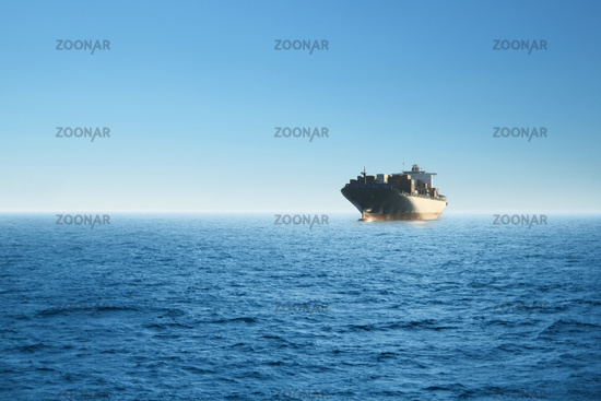Cargo ship at the sea. Environment, business and transportation concept.