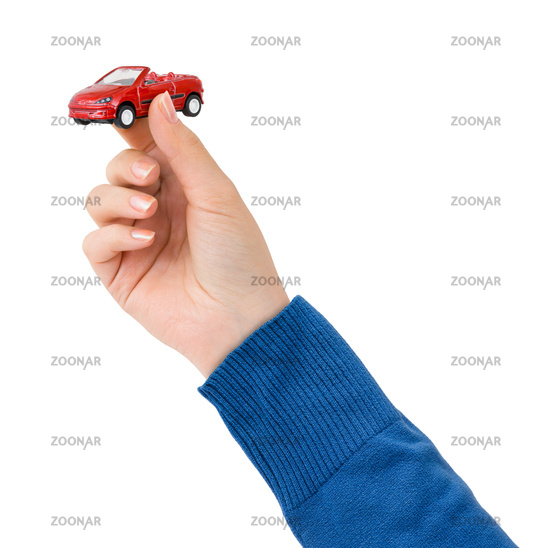 Hand and toy car