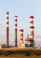 Four Industrial Refinery Towers