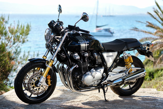 Majorca, Spain - May 29, 2019: On foreground lonely Honda CB1100 model modern bike, on background yachts moored on Mediterranean waters