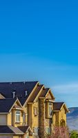 Panorama frame Exterior of lavish house with mountain and blue sky background on a sunny day