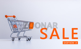 "Sale: Shopping cart and ""Sale – Shop now"" lettering"